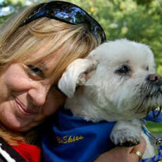 Andi holding a dog