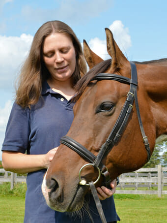 Dr. Natalie Rosamund with a horse
