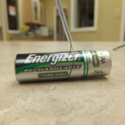 Loop instrument grasping an Energizer battery