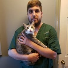 Corey holding a cat