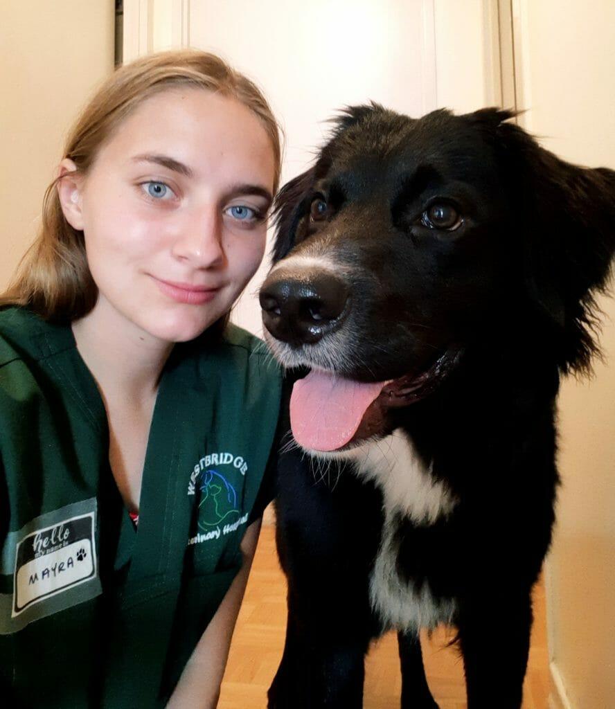 Mayra with a dog